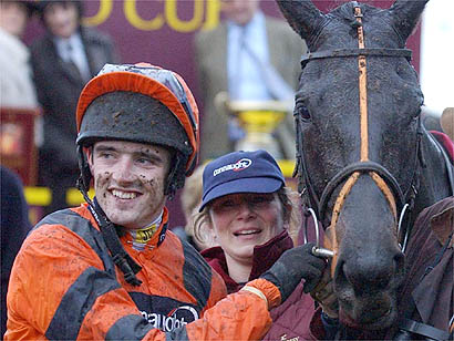 Strong Flow and Ruby Walsh after winning the Hennessy Cognac Gold Cup at Newbury /PA